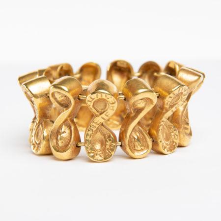 Après la pluie le beau temps by Line Vautrin - semi-rigid bracelet in gilded bronze - France - 01